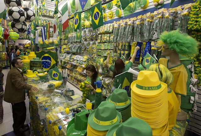 A customer shops for national regalia at a shop for Brazil and World Cup soccer fans in Sao Paulo, Brazil, Wednesday, May 21, 2014. Brazil is host to the international soccer tournament that begins June 12. (AP Photo/Andre Penner)