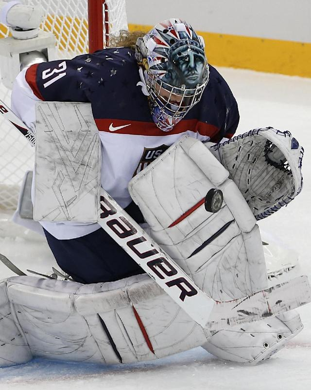 USA Goalkeeper Jessie Vetter blocks a shot on the goal during the 2014 Winter Olympics women's ice hockey game against Canada at Shayba Arena, Wednesday, Feb. 12, 2014, in Sochi, Russia. (AP Photo/Petr David Josek)