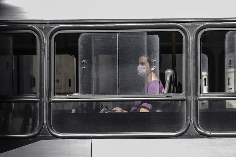 SAO PAULO, April 5, 2020 -- A woman wearing a face mask is seen on a bus amid covid-19 outbreak in Sao Paulo, Brazil, on April 4, 2020. The Brazilian Ministry of Health reported on Saturday 73 new deaths from COVID-19, bringing the death toll to 432 in the country. The number of COVID-19 cases in the country rose from 9,056 to 10,278 within the past 24 hours, according to the authorities. (Photo by Rahel Patrasso/Xinhua via Getty) (Xinhua/Rahel Patrasso via Getty Images)