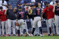 Cleveland Indians first baseman Yu Chang (2) and third baseman Jose Ramirez (11) celebrate with their teammates after a baseball game against the New York Yankees, Saturday, Sept. 18, 2021, in New York. (AP Photo/John Minchillo)