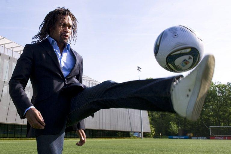 Christian Karembeu plays with a ball outside the FIFA headquarters on May 10, 2011 in Zurich