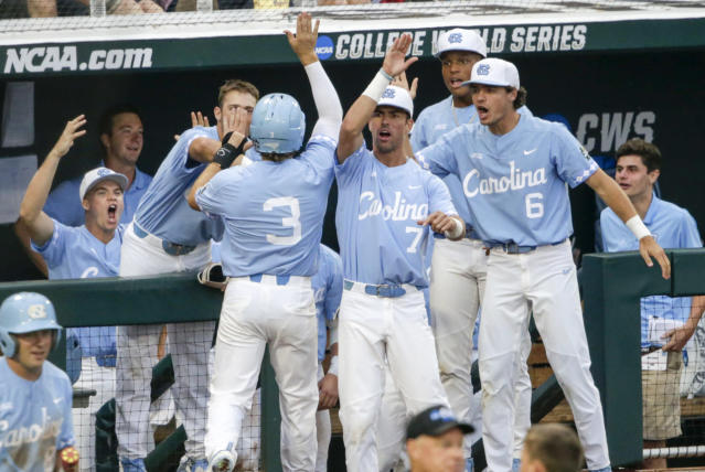 North Carolina players greet Kyle Datres (3) after he and Michael Busch scored on a double by Brandon Riley during the third inning of an NCAA College World Series baseball elimination game against Oregon State in Omaha, Neb., Wednesday, June 20, 2018. (AP Photo/Nati Harnik)