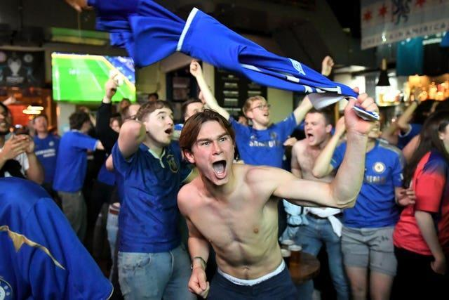 Chelsea fans celebrate the goal of the game at the Chelsea Pensioner pub in London