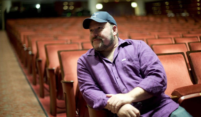 "In this March 29, 2013 photo, composer Frank Wildhorn sits inside a theater in West Palm Beach, Fla. Wildhorn first found success as a pop and R&B songwriter, penning Whitney Houston's ballad ""Where Do Broken Hearts Go."" He ruled Broadway in the late 1990s when he had three shows running simultaneously, a nearly four-year run for ""Jekyll and Hyde,"" ""The Scarlett Pimpernel"" and ""The Civil War,"" which all were nominated for Tony Awards. Now, Wildhorn's eighth Broadway show, a revamped revival of ""Jekyll and Hyde,"" opens on April 18. (AP Photo/J Pat Carter)"