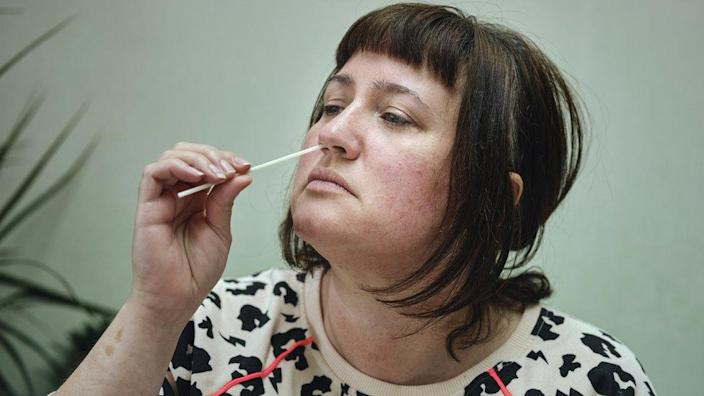 A woman taking a Covid test