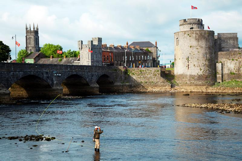 Shannon River with Thomond Bridge and King Johns Castle, Limerick, Ireland | Carl Bruemmer—Design Pics/Getty Images