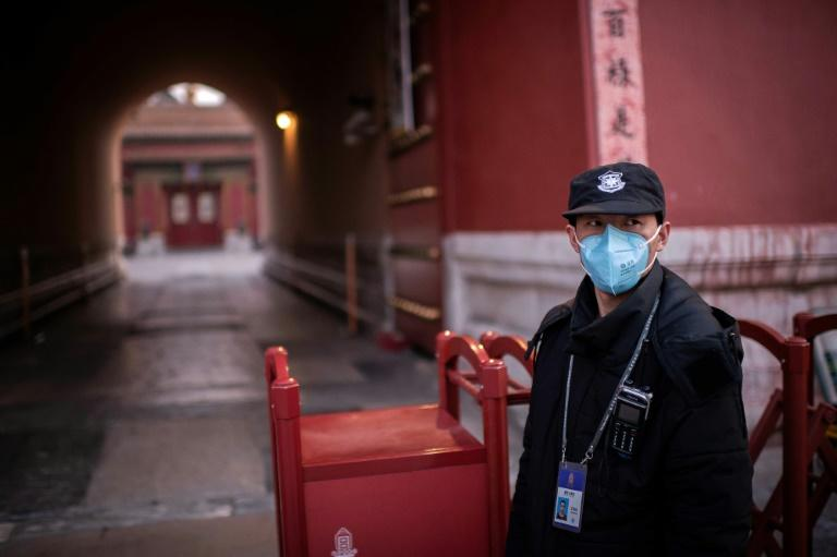 The virus has continued to spread across China despite the drastic travel restrictions and people wearing face masks (AFP Photo/NICOLAS ASFOURI)