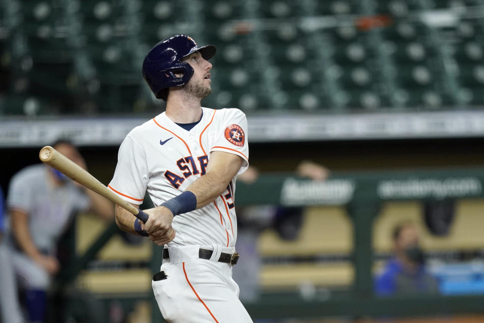 Houston Astros' Kyle Tucker watches his two-run home run against the Texas Rangers during the second inning of a baseball game Thursday, Sept. 17, 2020, in Houston. (AP Photo/David J. Phillip)
