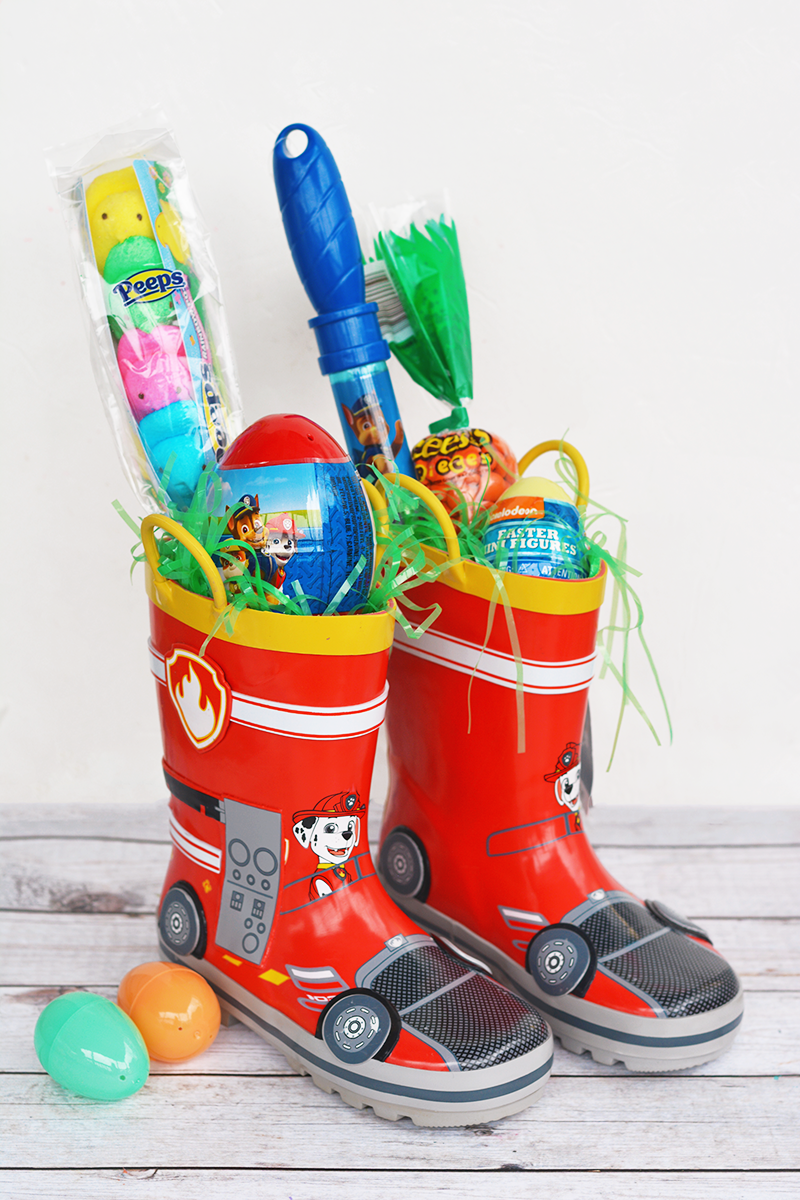 """<p>Instead of buying a basket that will only be used once a year, fill up a new pair of rain boots with small gifts this Easter.</p><p><em><a href=""""http://www.iheartartsncrafts.com/rain-boot-easter-basket-idea/"""" rel=""""nofollow noopener"""" target=""""_blank"""" data-ylk=""""slk:Get the tutorial from I Heart Arts N Crafts »"""" class=""""link rapid-noclick-resp"""">Get the tutorial from I Heart Arts N Crafts »</a></em> </p>"""