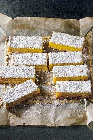 """<p>Sweet lavender is the perfect complement for zesty lemons.</p><p><strong><a href=""""http://www.countryliving.com/food-drinks/recipes/a5052/lemon-lavender-bars-recipe-clx1013/"""" rel=""""nofollow noopener"""" target=""""_blank"""" data-ylk=""""slk:Get the recipe."""" class=""""link rapid-noclick-resp"""">Get the recipe.</a></strong></p>"""
