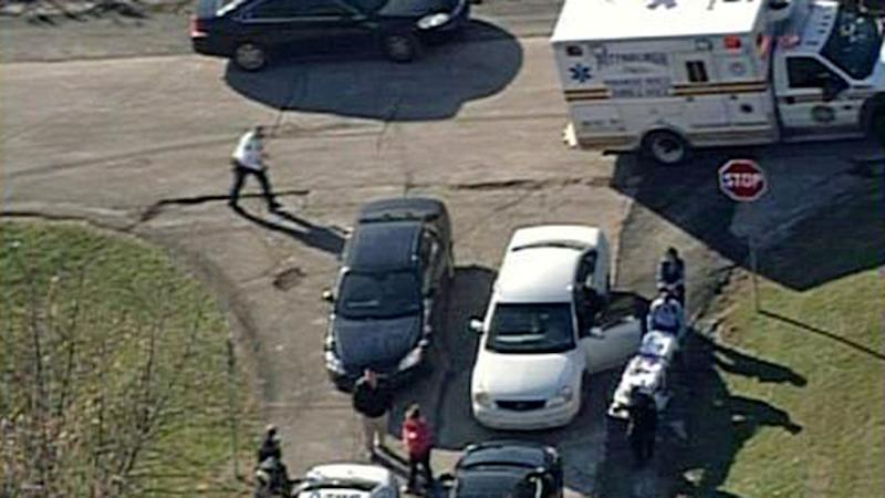 In this aerial image provided by KDKA-TV, emergency personal head to the scene near Brashear High School in Pittsburgh, Wednesday, Nov. 13, 2013. Pittsburgh police reported Wednesday that three people were shot near the school. The condition of the person in the stretcher was unknown Wednesday. (AP Photo/KDKA-TV)