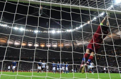 Italian goalkeeper Gianluigi Buffon makes a full stretch save during the Euro 2012 semi-final between Germany and Italy at the National Stadium in Warsaw. Italy won 2-1