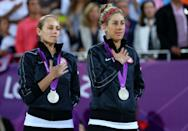 """Silver medallists <a href=""""http://sports.yahoo.com/olympics/beach-volleyball/jennifer-kessy-1132111/"""" data-ylk=""""slk:Jennifer Kessy"""" class=""""link rapid-noclick-resp"""">Jennifer Kessy</a> (L) and <a href=""""http://sports.yahoo.com/olympics/beach-volleyball/april-ross-1131520/"""" data-ylk=""""slk:April Ross"""" class=""""link rapid-noclick-resp"""">April Ross</a> of the United States celebrate on the podium during the medal ceremony for the Women's Beach Volleyball on Day 12 of the London 2012 Olympic Games at the Horse Guard's Parade on August 8, 2012 in London, England. (Getty Images)"""
