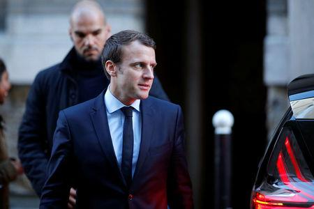 Emmanuel Macron, head of the political movement En Marche !, or Onwards !, and candidate for the 2017 presidential election, leaves his home in Paris