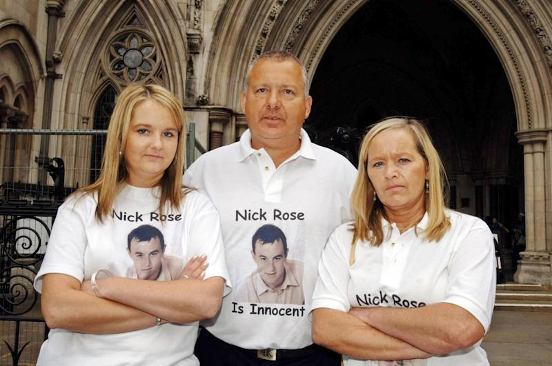 RETRANSMISSION amending catchline. Neil and Kay Rose stand with their daughter, Carley, outside the High Court in London, where lawyers for their son, Nicholas, are launching an appeal against his conviction at Exeter Crown Court for murdering 16-year-old Charlotte Pinkney arguing that it should be overturned as 'unsafe'.