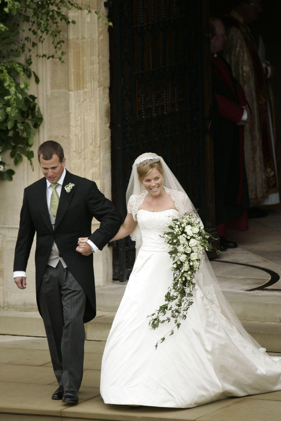 <p>Kelly, who married the Queen's grandson, Peter Phillips, chose a sweetheart neckline with a lace shrug for her wedding ceremony.</p>