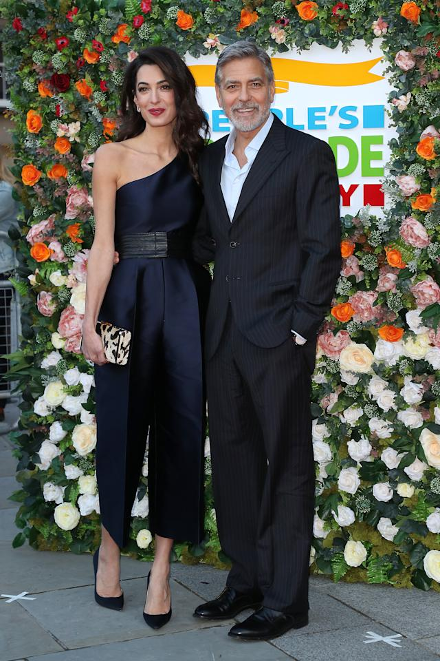 <p>For an event in Edinburgh, the human rights lawyer and activist opted to wear a satin, navy, cropped jumpsuit from British designer Stella McCartney. <em>[Photo: Getty]</em> </p>