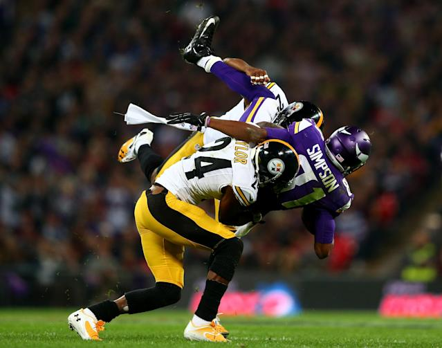 LONDON, ENGLAND - SEPTEMBER 29: Wide receiver Jerome Simpson #81 of the Minnesota Vikings is tackled by cornerback Ike Taylor #24 of the Pittsburgh Steelers during the NFL International Series game between Pittsburgh Steelers and Minnesota Vikings at Wembley Stadium on September 29, 2013 in London, England. (Photo by Michael Steele/Getty Images)