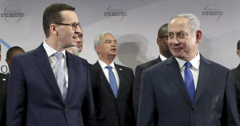 "File -- In this Thursday, Feb. 14, 2019 photo Poland's Prime Minister Mateusz Morawiecki, left, and Israeli Prime Minister Benjamin Netanyahu, right, attend a group photo during a meeting in Warsaw, Poland. Poland's prime minister canceled plans for his country to send a delegation to meeting in Jerusalem on Monday after the acting Israeli foreign minister Israel Katz said that Poles ""collaborated with the Nazis"" and ""sucked anti-Semitism from their mothers' milk"". (AP Photo/Michael Sohn)"