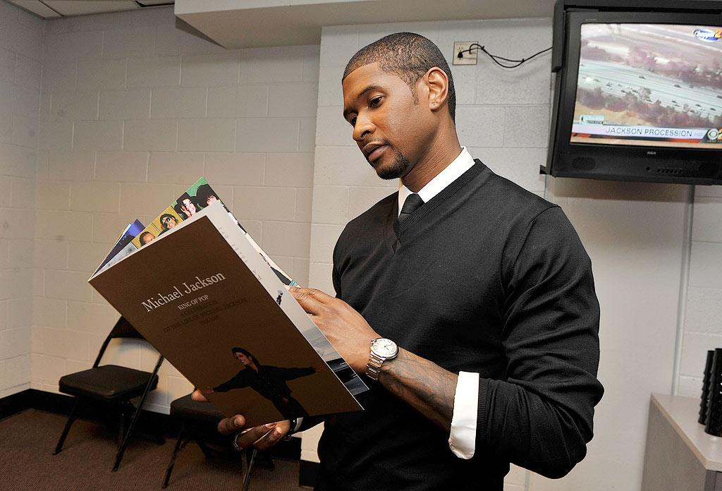 """Usher flipped through the program for Jackson's memorial service. """"I would not be the artist, performer, and philanthropist I am today without the influence of Michael,"""" said the R&B star. """"I have great admiration and respect for him, and I'm so thankful I had the opportunity to meet and perform with such a great entertainer, who in so many ways transcended the culture."""" Kevin Mazur/MJ Memorial/<a href=""""http://www.wireimage.com"""" target=""""new"""">WireImage.com</a> - July 7, 2009"""