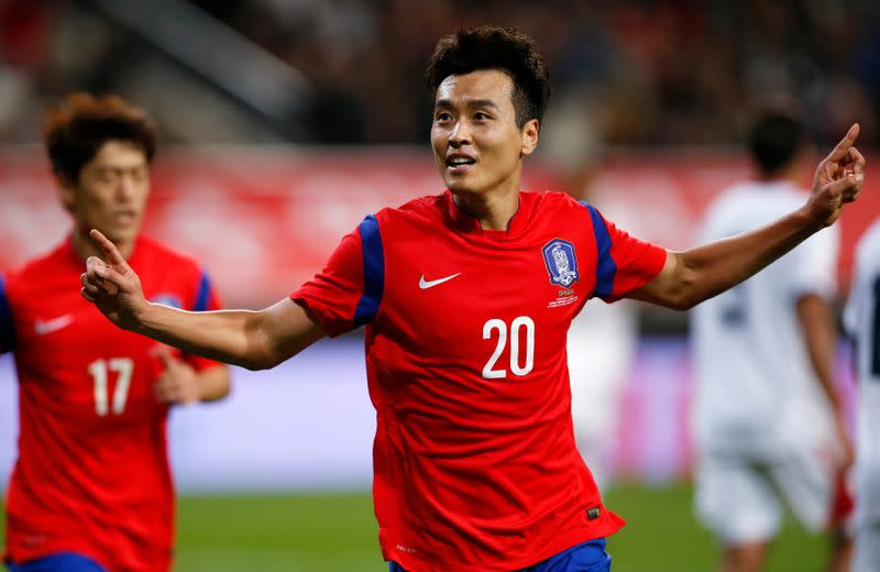 FILE PHOTO: South Korea's Lee Dong-gook celebrates his goal against Costa Rica during their friendly soccer match at Seoul World Cup Stadium in Seoul