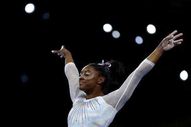 PHOTO: Simone Biles performs on the vault in the women's all-around final at the Gymnastics World Championships in Stuttgart, Germany, Oct. 10, 2019. (Matthias Schrader/AP)