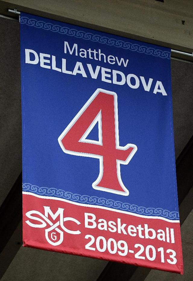 A banner bearing the No. 4 of former Saint Mary's basketball player Matthew Dellavedova is displayed during a jersey retirement ceremony before an NCAA college basketball game between Saint Mary's and BYU, Saturday, Feb. 15, 2014, in Moraga, Calif. Dellavedova played for Saint Mary's from 2009-2013 and now plays for the Cleveland Cavaliers. (AP Photo/Ben Margot)