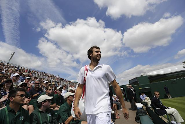 Ernests Gulbis of Latvia arrives for his match against Sergiy Stakhovsky of Ukraine at the All England Lawn Tennis Championships in Wimbledon, London, Wednesday, June 25, 2014. (AP Photo/Ben Curtis)