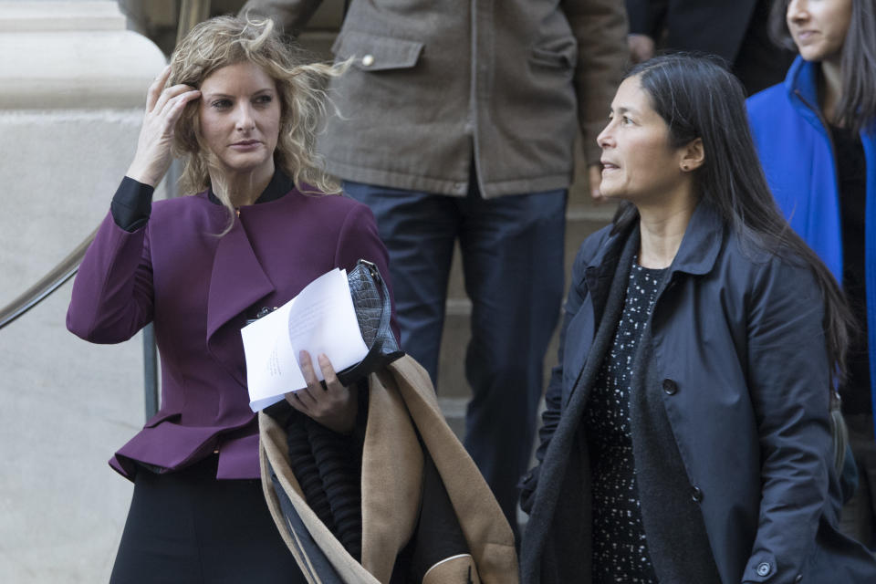 Summer Zervos, left, leaves New York state appellate court with here attorney Mariann Wang, Thursday, Oct. 18, 2018, in New York. President Donald Trump's lawyers hope to persuade an appeals court to dismiss or delay Zervos' claim that he defamed her by calling her a liar after she accused him of unwanted kissing and groping. (AP Photo/Mary Altaffer)