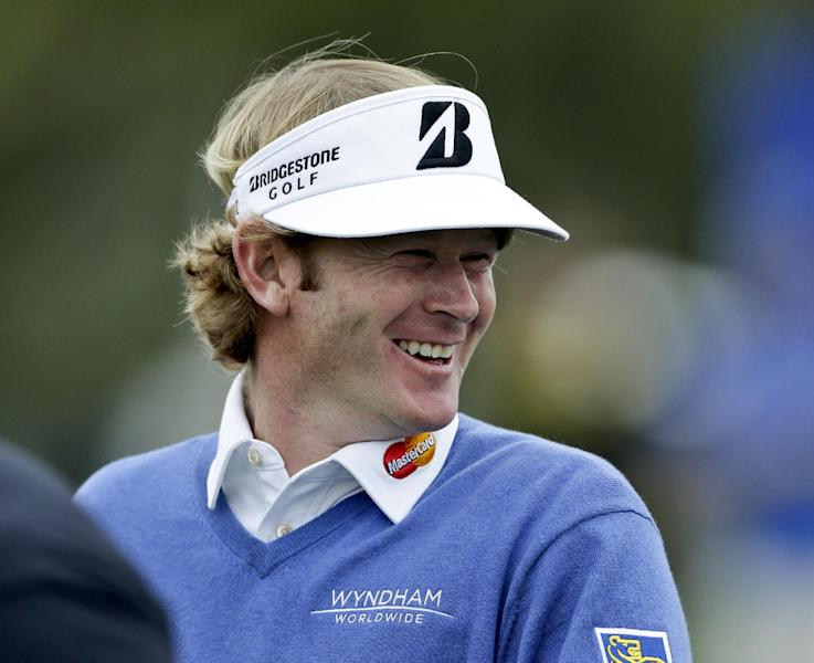 Brandt Snedeker sports a big smile on the fourth hole on the North Course at Torrey Pines during the first round of the Farmers Insurance Open golf tournament Thursday, Jan. 24, 2013, in San Diego. (AP Photo/Gregory Bull )