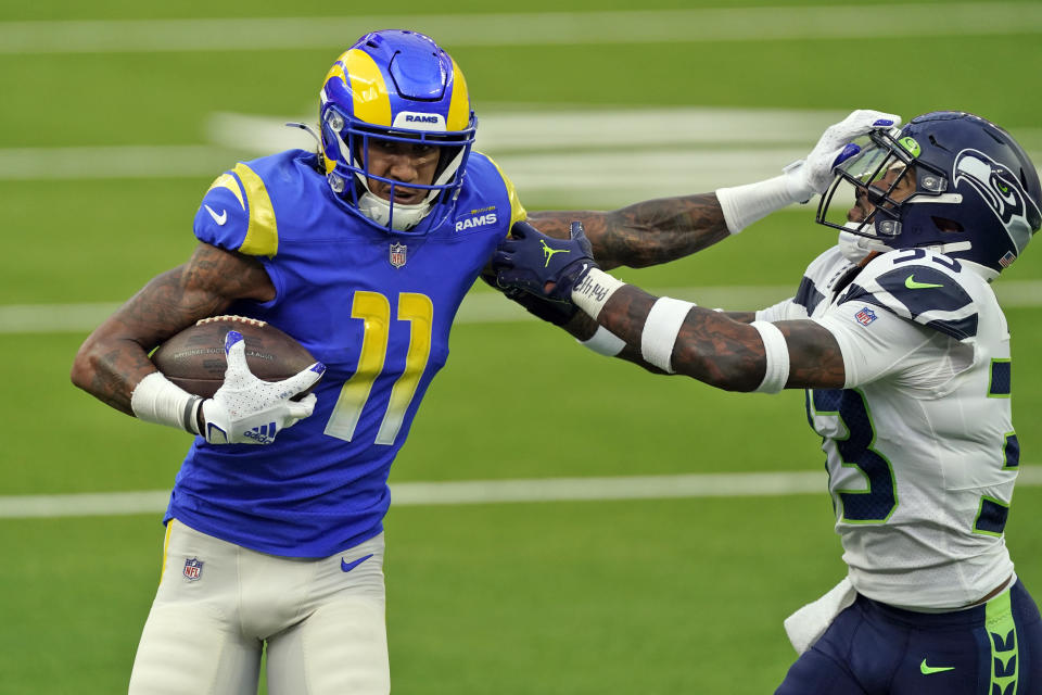 Los Angeles Rams wide receiver Josh Reynolds (11) stiff-arms Seattle Seahawks strong safety Jamal Adams during the first half of an NFL football game Sunday, Nov. 15, 2020, in Inglewood, Calif. (AP Photo/Ashley Landis)