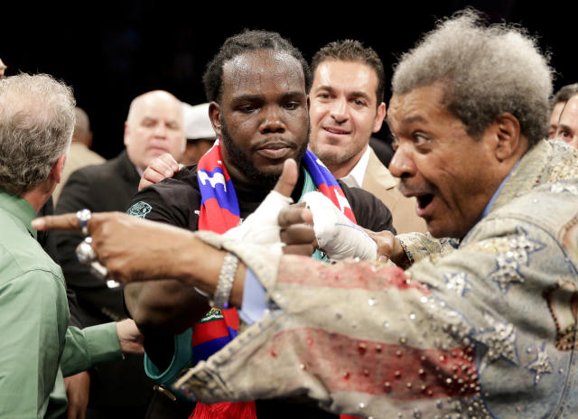 Bermane Stiverne, center, celebrates his win over Chris Arreola with promoter Don King after a rematch for the WBC heavyweight boxing title in Los Angeles, Saturday, May 10, 2014. (AP Photo/Chris Carlson)