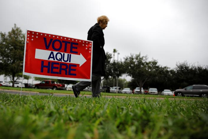 <p>A woman arrives at a polling station in Lark Community Center as the early voting for midterm elections started in Texas, in McAllen, Texas, Oct. 22, 2018. (Photo: Carlos Barria/Reuters) </p>
