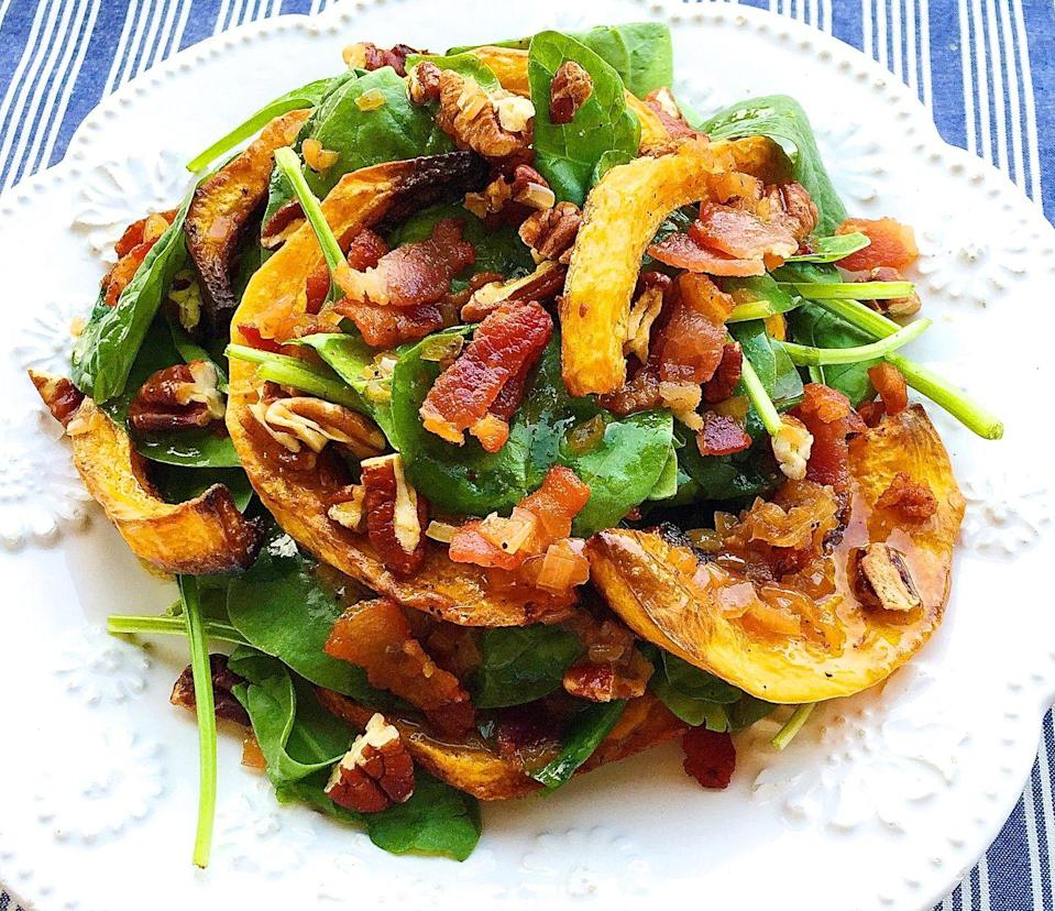 """<p>This fall salad will kill it on your Thanksgiving table.</p><p>Get the recipe from <a href=""""https://www.delish.com/cooking/recipe-ideas/recipes/a43811/crispy-butternut-squash-spinach-salad-with-bacon-shallot-vinaigrette-recipe/"""" rel=""""nofollow noopener"""" target=""""_blank"""" data-ylk=""""slk:Delish"""" class=""""link rapid-noclick-resp"""">Delish</a>.</p>"""