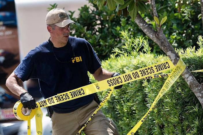 A member of the FBI works on June 13, 2016 in Orlando, Florida (AFP Photo/Brendan Smialowski)