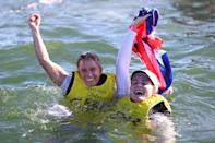 <p>Hannah Mills (left) and Eilidh McIntyre (right) of Team Great Britain jump into the water after winning gold in the Women's 470 class medal race at Enoshima Yacht Harbour on August 4.</p>