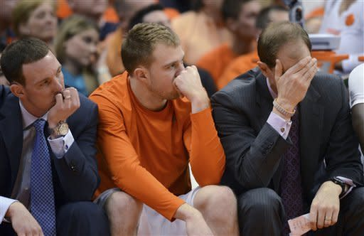 Syracuse assistant coach Gerry McNamara, left , Trevor Cooney, and assistant coach Mike Hopkins react after Georgetown scored late in the second half of an NCAA college basketball game in Syracuse, N.Y., Saturday, Feb. 23, 2013. Georgetown won 57-46. (AP Photo/Kevin Rivoli)