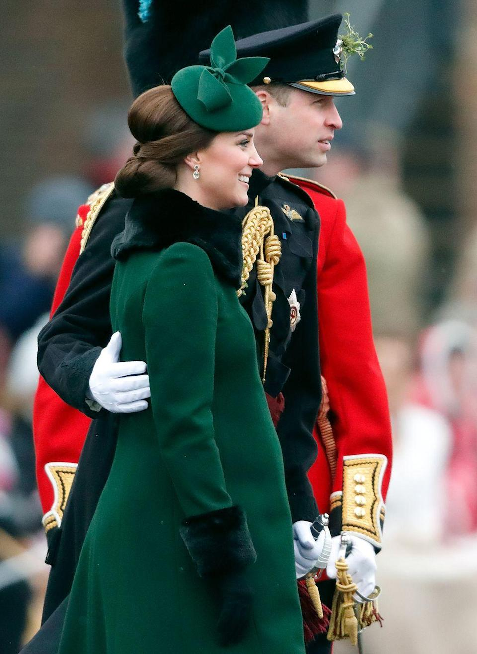 <p>The Duke of Cambridge was photographed putting an arm around his pregnant wife at the annual Irish Guards St Patrick's Day Parade at Cavalry Barracks just a month before she gave birth to Prince Louis, March 2018.</p>