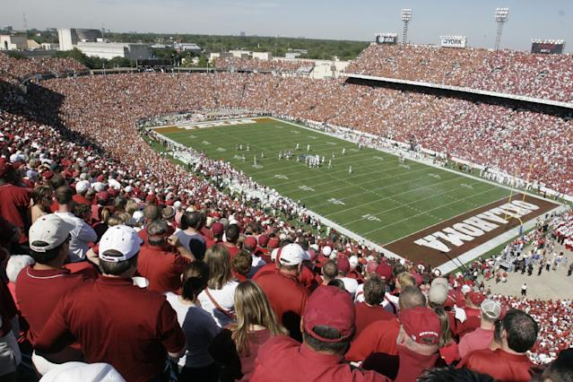 The Cotton Bowl filled with a sold out crowd stands before the start of the annual Texas/Oklahoma football game, Saturday, Oct. 7, 2006, in Dallas. (AP Photo/Ron Heflin)