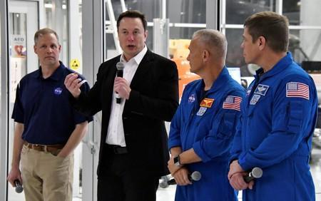 NASA Administrator Jim Bridenstine, SpaceX Chief Engineer Elon Musk, NASA astronauts Doug Hurley and Bob Behnken, take questions from the media after a tour of SpaceX headquarters in Hawthorne