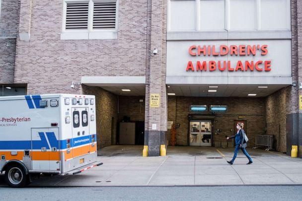 PHOTO: An ambulance sits outside of NewYork-Presbyterian Morgan Stanley Children's Hospital, where patients have been treated for a severe inflammatory syndrome linked to the coronavirus, in New York, May 11, 2020. (Gabriela Bhaskar/New York Times via Redux, FILE)