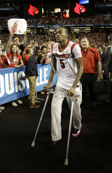 Louisville guard Kevin Ware walks out to the court before the first half of the NCAA Final Four tournament college basketball championship game against the Michigan, Monday, April 8, 2013, in Atlanta.(AP Photo/John Bazemore)