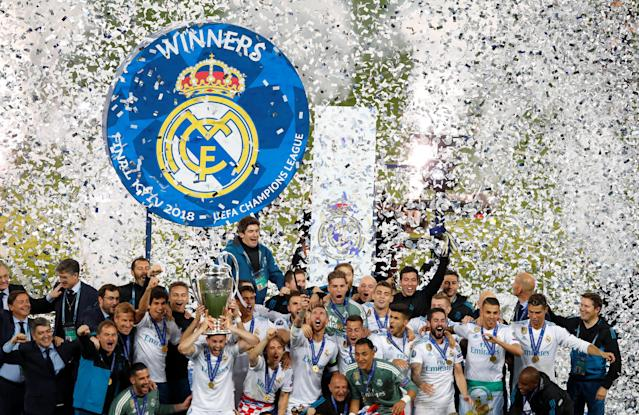 Soccer Football - Champions League Final - Real Madrid v Liverpool - NSC Olympic Stadium, Kiev, Ukraine - May 26, 2018 Real Madrid celebrate winning the Champions League with the trophy REUTERS/Phil Noble