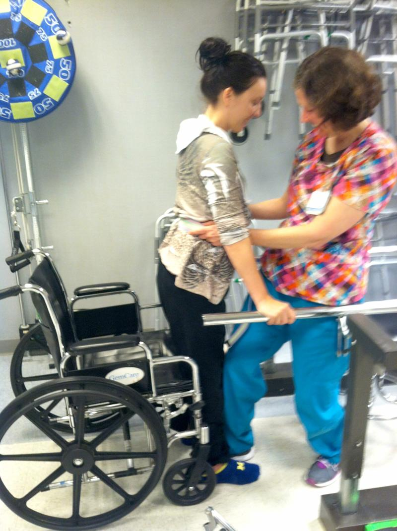 Kaylee Hardenbrook receives physical therapy in 2014 during her recovery.