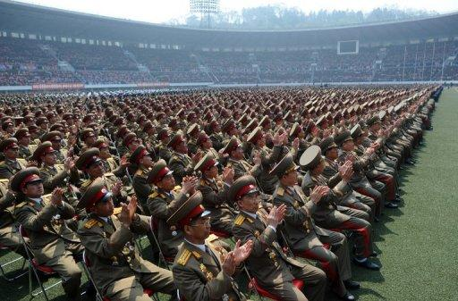The crowd filled the stadium as well as rows of seats covering the artificial grass pitch at today's Pyongyang ceremony
