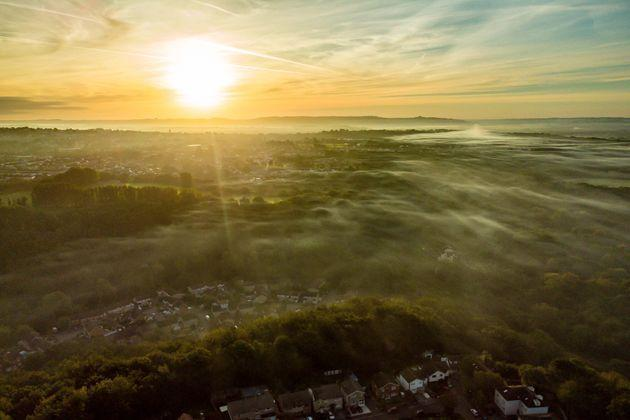 Low mist forms at sunrise over Bristol as the UK leaves summer behind. (Photo: Ben Birchall - PA Images via Getty Images)