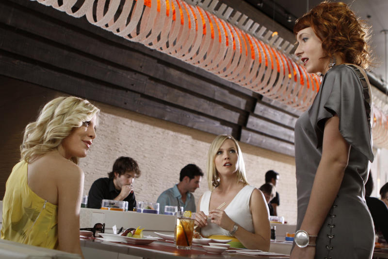 """FILE - In this file production still released by The CW Network, Tori Spelling, left, Jennie Garth, center, and Diablo Cody, playing herself, are shown in a scene from """"90210."""" The countdown is under way for the end of the TV series """"90210."""" The CW network announced Thursday, Feb. 28, 2013 that the show will wrap in May after five seasons. That means it will have half the run of its inspiration, """"Beverly Hills, 90210,"""" which aired on Fox from 1990 to 2000 (AP Photo/The CW, Michael Desmond, File)"""