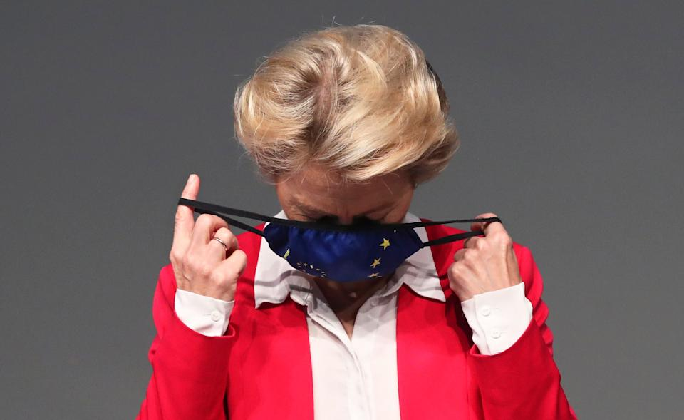 European Commission President Ursula von der Leyen removes her face mask before delivering a speech on the EU's coronavirus recovery fund plan at the Campalimaud Foundation in Lisbon, Tuesday, Sept. 29, 2020. (AP Photo/Pedro Rocha) (Photo: ASSOCIATED PRESS)