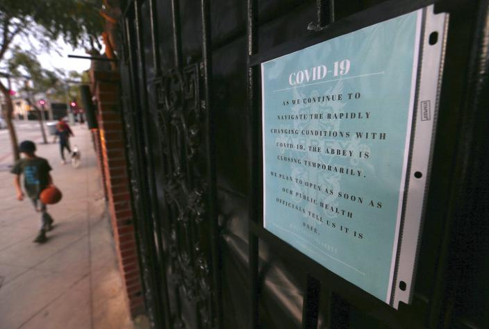 """<span class=""""caption"""">The Abbey, one of Los Angeles' most famous gay bars, announces its temporary closure due to the coronavirus pandemic.</span> <span class=""""attribution""""><a class=""""link rapid-noclick-resp"""" href=""""https://www.gettyimages.com/detail/news-photo/sign-on-the-fence-of-the-abbey-in-west-holywood-announces-news-photo/1208074025?adppopup=true"""" rel=""""nofollow noopener"""" target=""""_blank"""" data-ylk=""""slk:Luis Sinco/Los Angeles Times via Getty Images"""">Luis Sinco/Los Angeles Times via Getty Images</a></span>"""