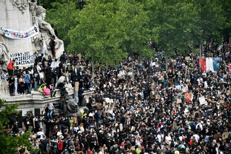 Thousands turned out in Paris and other French cities on Saturday to protest racism and police brutality (AFP Photo/Anne-Christine POUJOULAT)